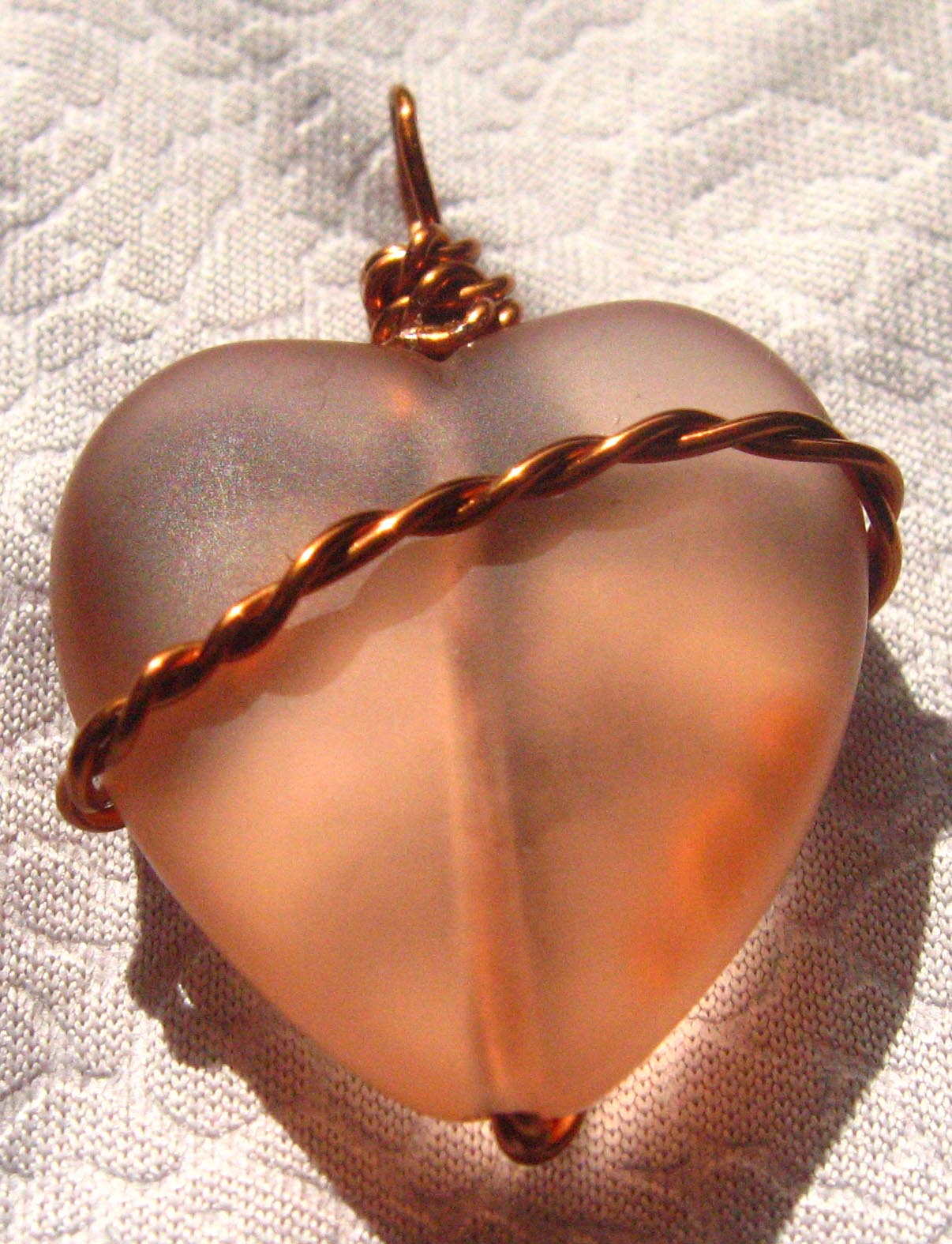 Side 2 of the Twisted Copper Wrapped Heart Pendant